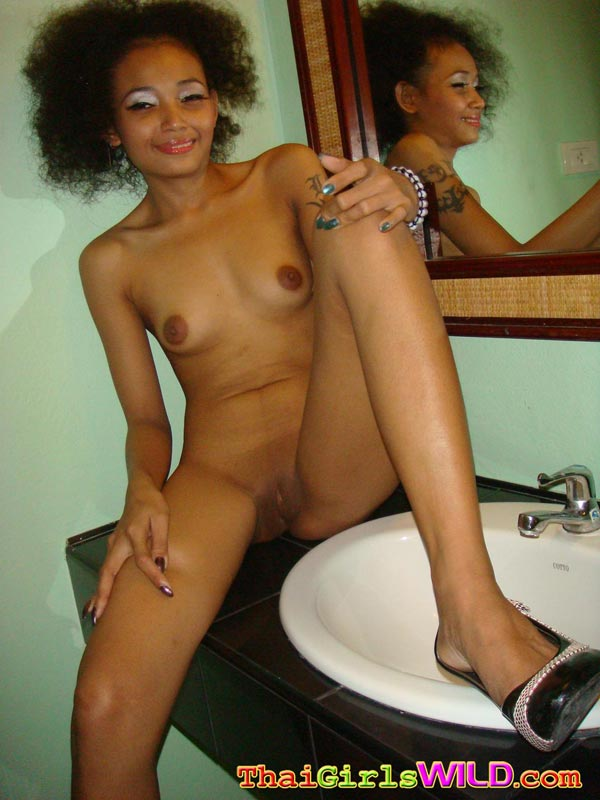 Girl nude flexing biceps