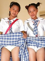 Two cute young Filipina schoolgirls strip naked to show pussy