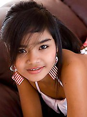 Mega petite Thai teen Panni strips out of her schoolgirl outfit