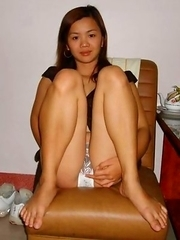 Asian cutie with hairy twat in slutty poses